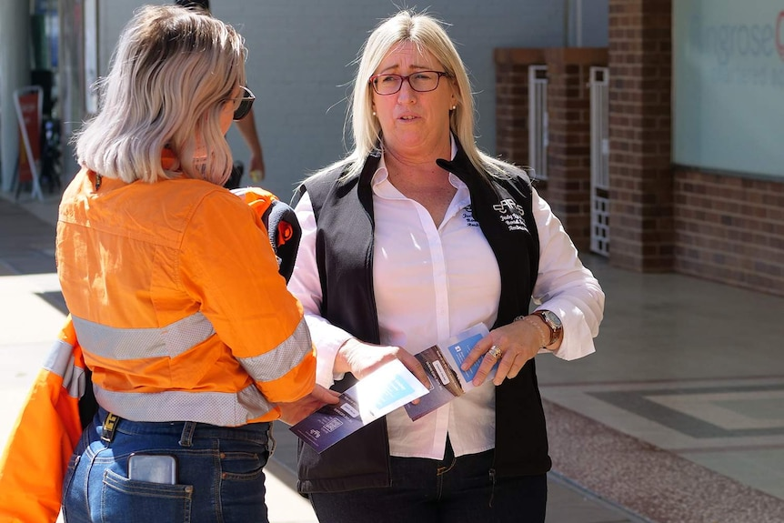 Two ladies in the street talking about road safety