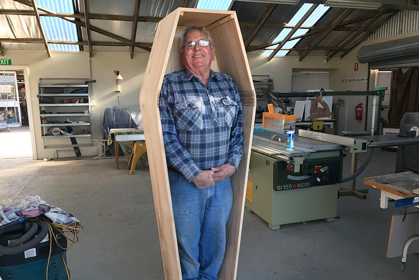 Russell Game tries his casket out for size.