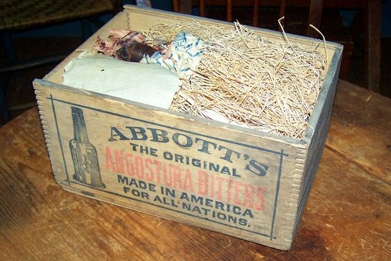 Wooden box with angosture bitters bottles inside