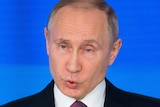 Vladimir Putin pulls a face during his speech