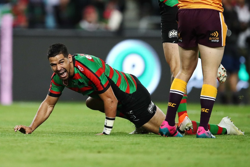 Cody Walker crawls along the ground after scoring a try to pay tribute to Greg Inglis and his goanna celebration.