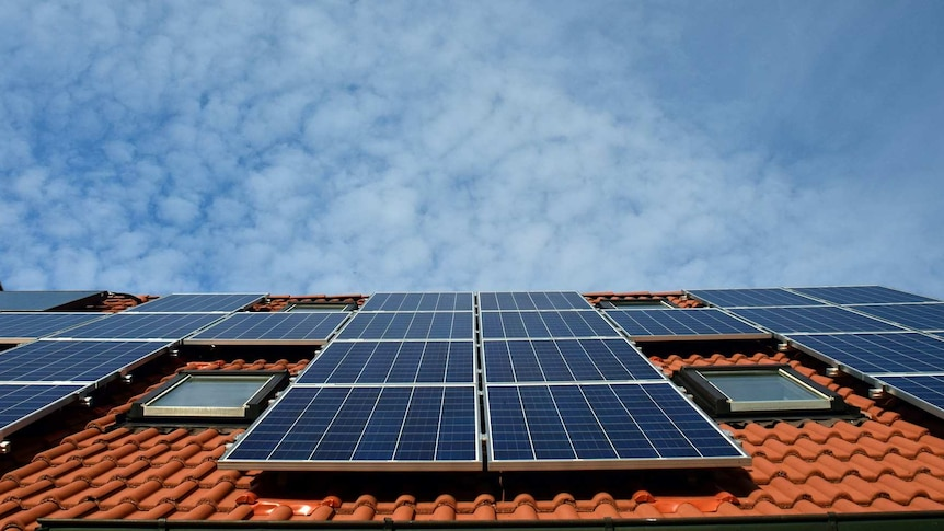 the roof of a house with solar panels
