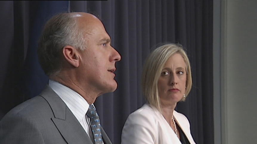 Chief Minister Katy Gallagher watches as Senator Eric Abetz explains the loan deal.