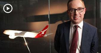 Qantas boss Alan Joyce in front of a model plane