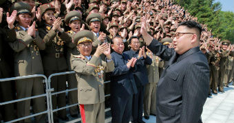 Kim Jong-un greets North Korean scientists.