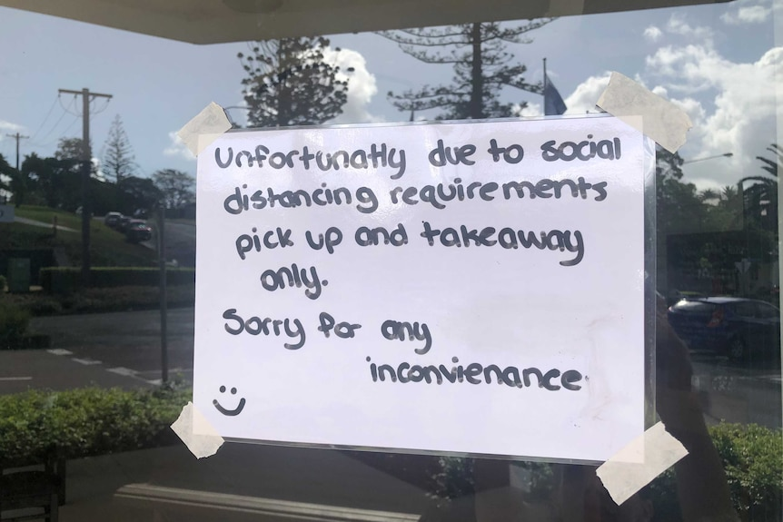 A sign on a restaurant window telling people they are only open for deliveries.