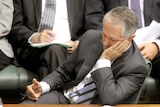 Opposition Leader Malcolm Turnbull leans on his hand, looking pensive