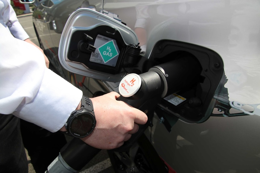 Close-up of the fuel tank of a hydrogen car as it is refuelled.