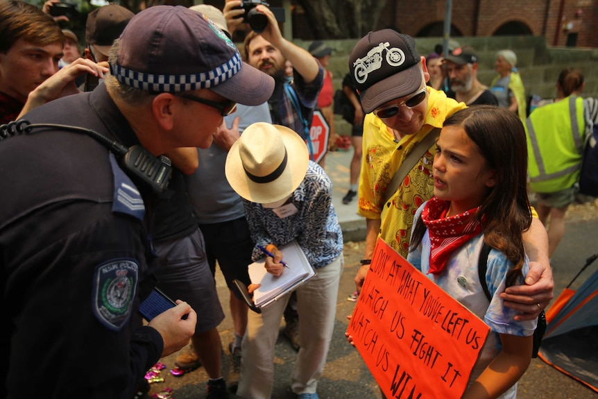 A young girl crying after being spoken to by police