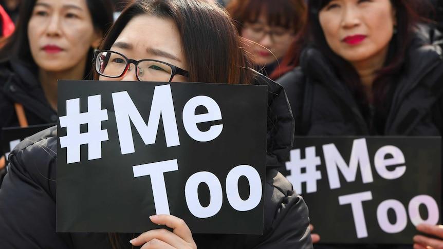 South Korean women holding up placards saying #MeToo.