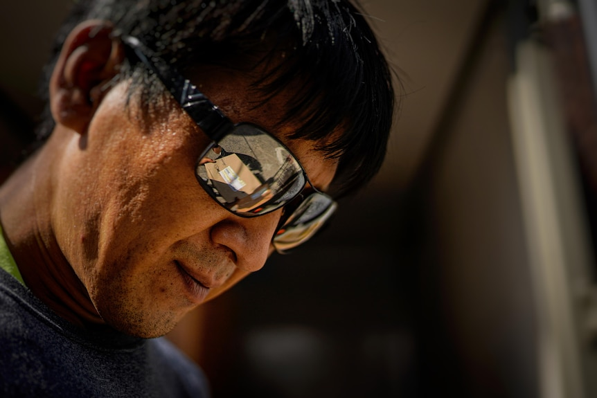 A parcel is reflected in Lee Seong-Wook's sunglasses.