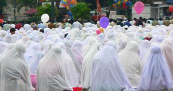 A group of women praying