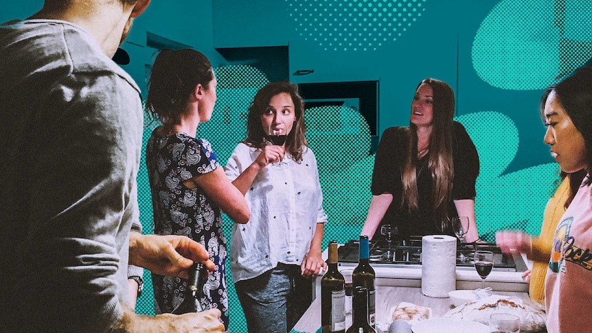 A group of people stand around a kitchen having drinks and making food for a story about why people share in their 30s