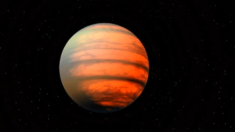 Picture of an orange and brown mottled planet against a black background.