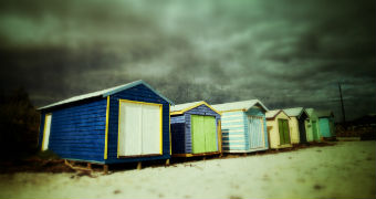 Storm clouds over beach boxes