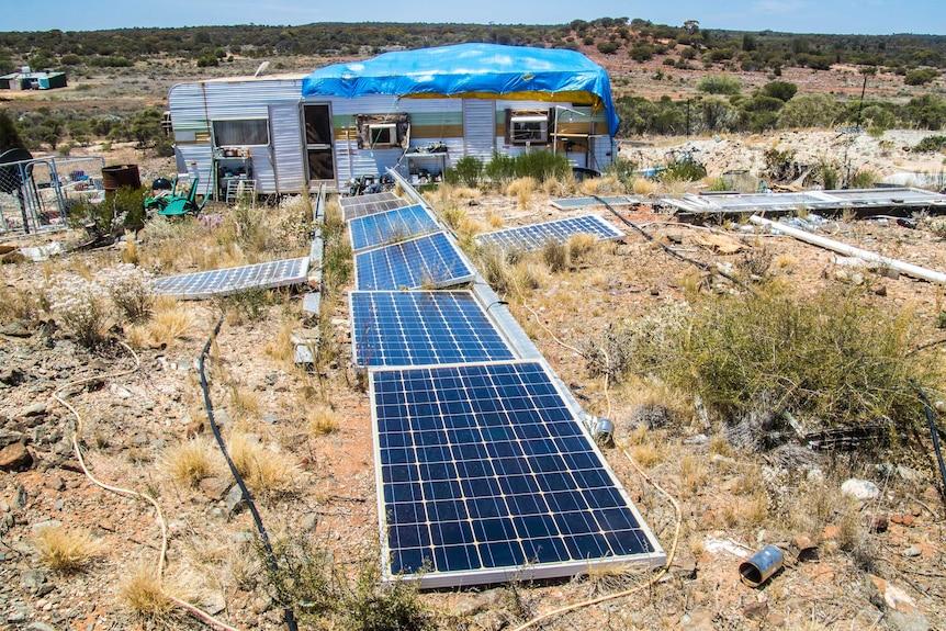 Solar panels power caravan in outback WA.