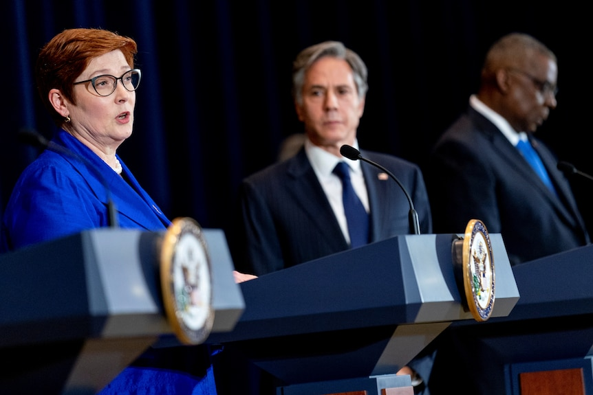 Australian Foreign Minister Marise Payne and US Secretary of State Anthony Blinken speak from lecterns at a bilateral meet