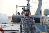 Michael John O'Donnell walks aboard a naval ship.