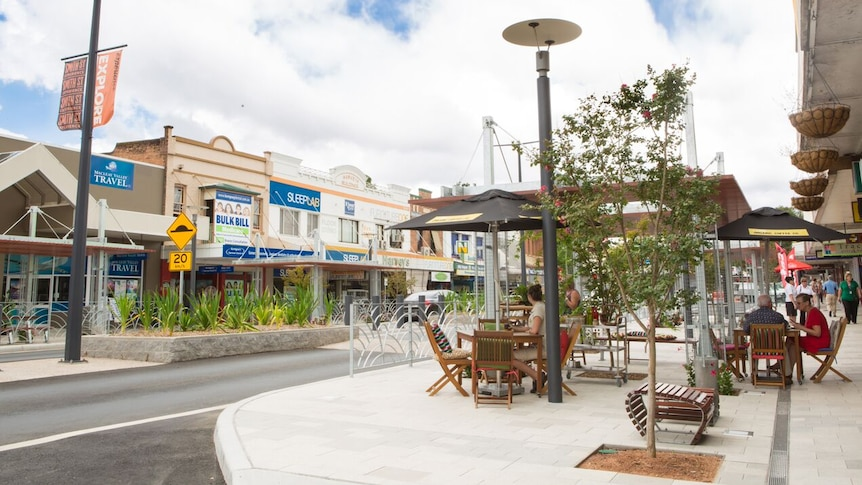 Smith Street in the Centre of Kempsey's CBD, showing cafes, greenery and pedestrians