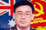 Dr Yang in military uniform with the Australian flag and Chinese MSS symbol in the background.