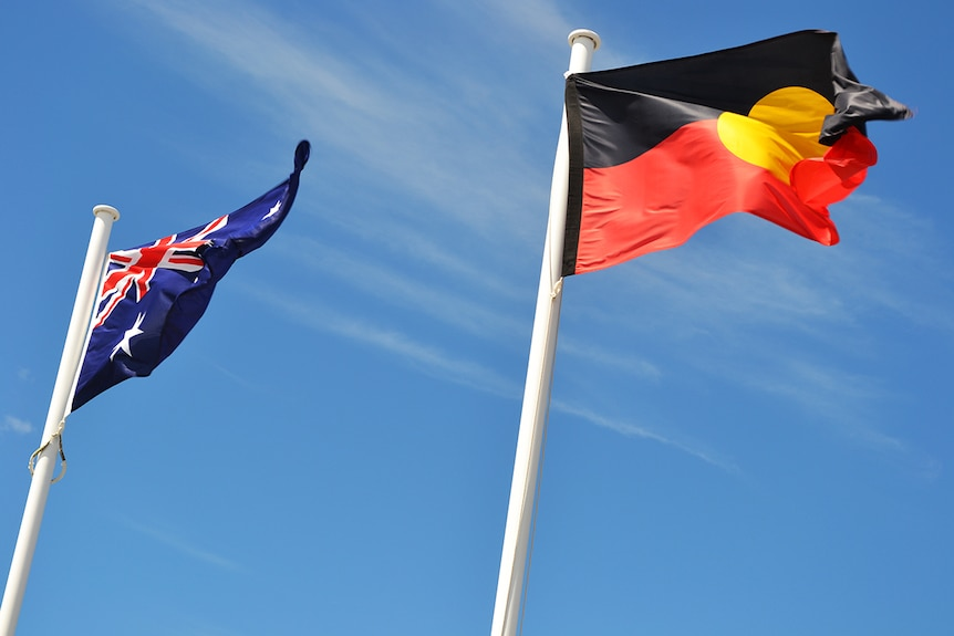 Australian and Aboriginal flags flying side by side.