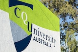 A green and white sign reads CQ University Australia