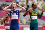 400m hurdlers celebrate after cross the finish line winning Olympic medals