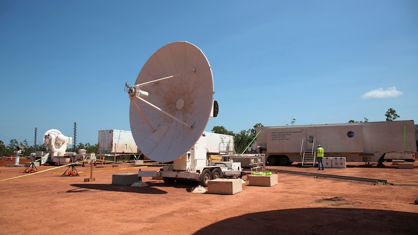 A satellite standing on the red earth of North-East Arnhem Land.