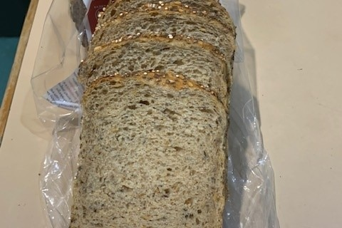A loaf of bread made with ancient grains.
