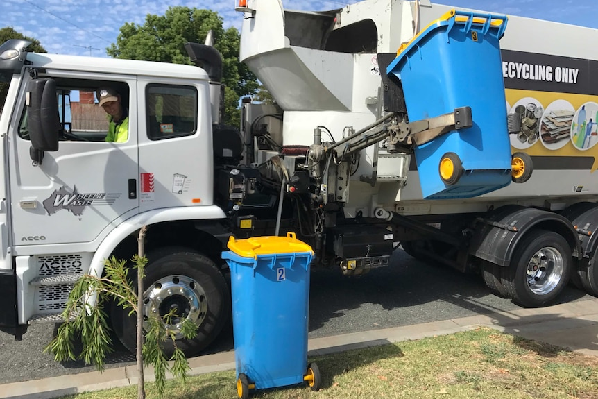 A Wheelie Waste truck picks up recycling bins in Shepparton.