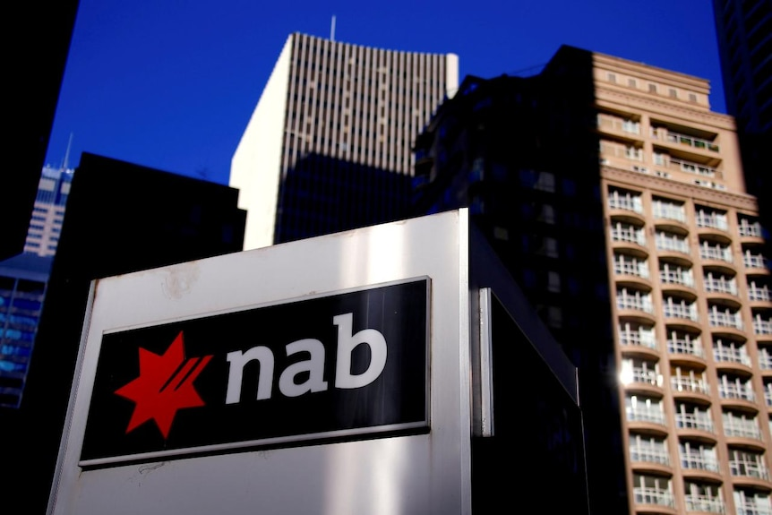 FILE PHOTO: The logo of the National Australia Bank is displayed outside their headquarters building in central Sydney, Australia August 4, 2017.