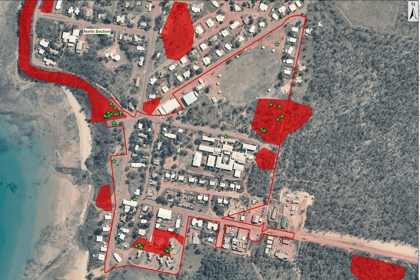 A close up aerial map of  Galiwinku properties lining the coast, with red markings highlighting asbestos sites.