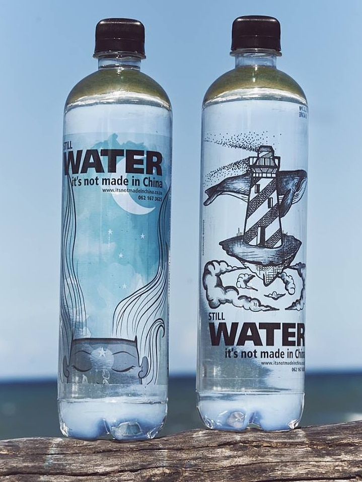"""Two bottles of water with the labels """"Still water. It's not made in China""""."""