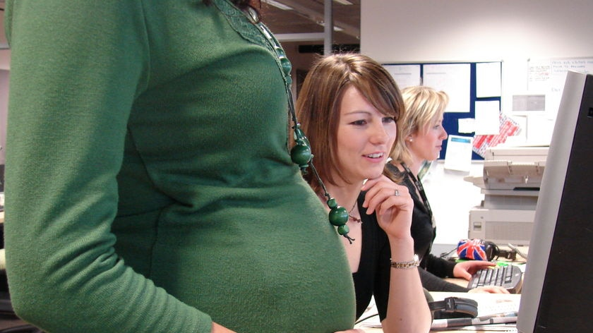 Pregnant woman in an office. (ABC, file photo)