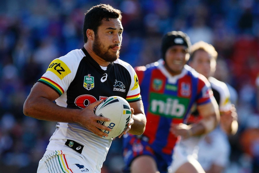 The Penrith Panthers' James Tamou runs the ball against the Newcastle Knights