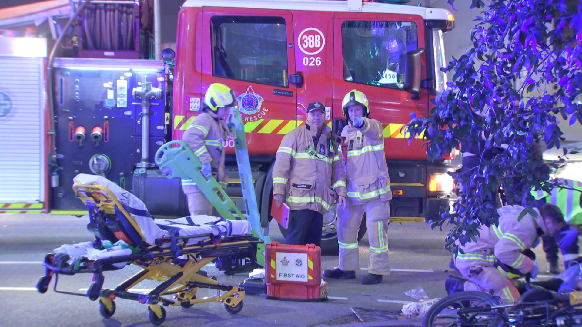 Emergency workers at an accident scene.