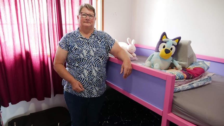 Karen Morris in Cooma stands at her granddaughters bed