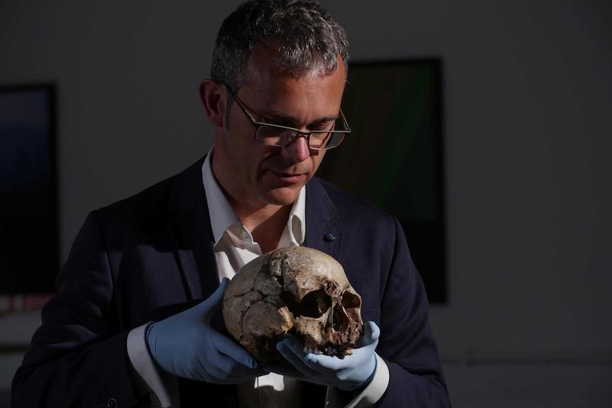 Professor Ian Barnes displays the skull of cheddar man