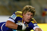 Decorated career ... Adam Thomson scores a try for the Highlanders in 2011