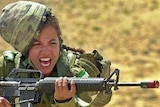An Israeli army female soldier shouts while holding a M16 rifle on May 23, 2005.