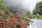 Rubble covers the Eastern Dorrigo Way at Coramba after a landslip caused by heavy rain.