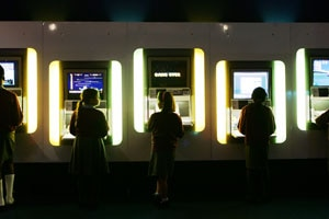 School children play arcade games at the Game On exhibition in London.