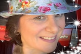 A woman wearing a floral hat.