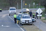 Police and police cars at an accident scene.