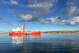 A construction vessel anchored off the coast of Ardrossan is sinking limestone blocks into the ocean.