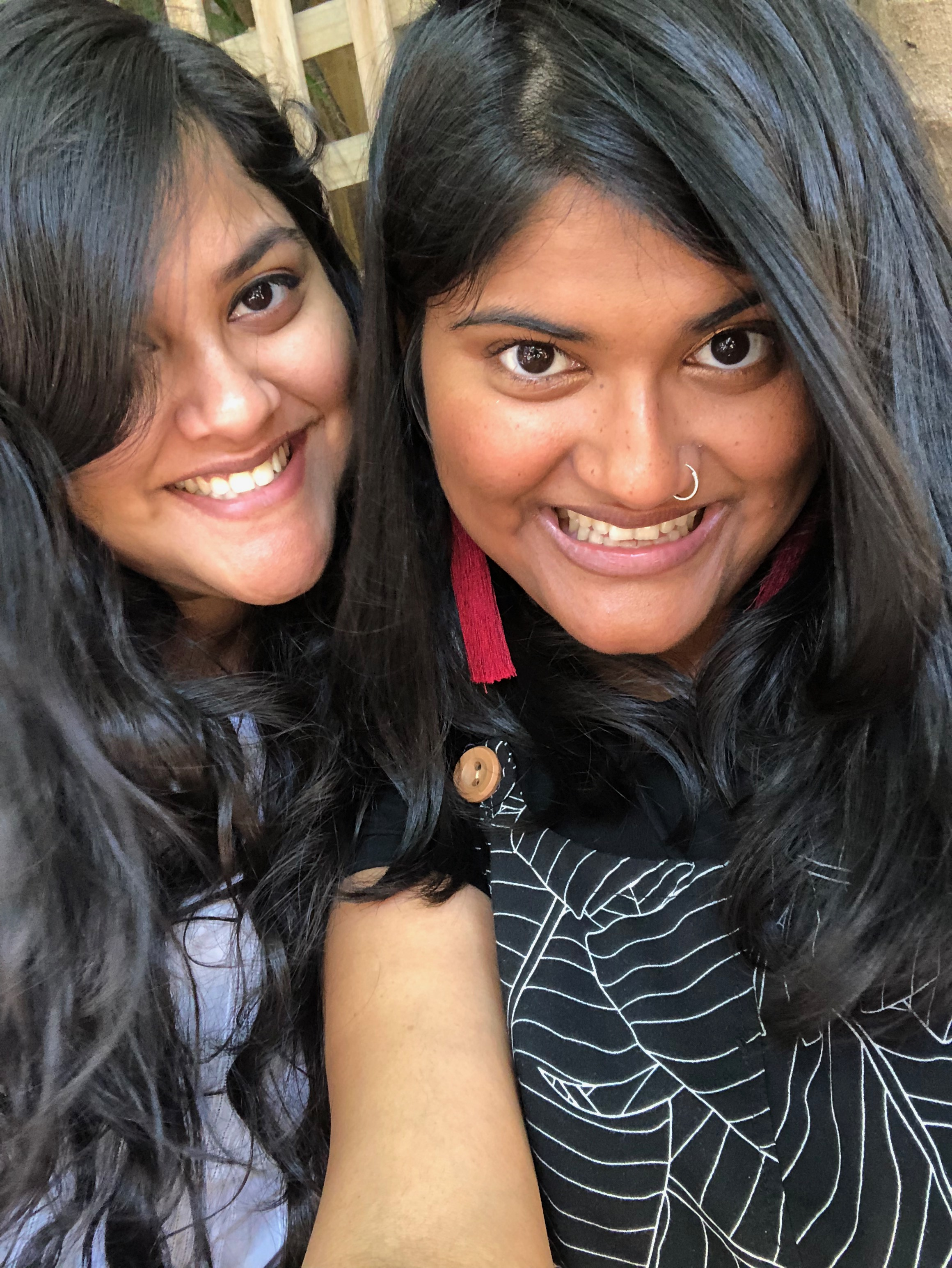 Two women smile in a selfie, for a story on choosing to get the AstraZeneca vaccine at 35.