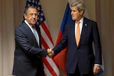 US Secretary of State John Kerry shakes hands with Russian Foreign Minister Sergey Lavrov.