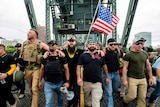 Proud Boys march across the Hawthorne Bridge in Portland