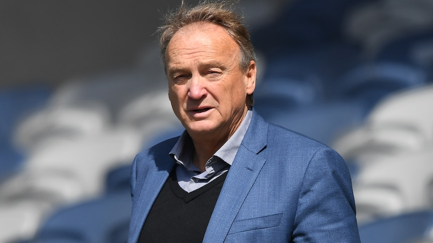 A photo of former Geelong Cats CEO Brian Cook standing at Kardinia Park in 2019.