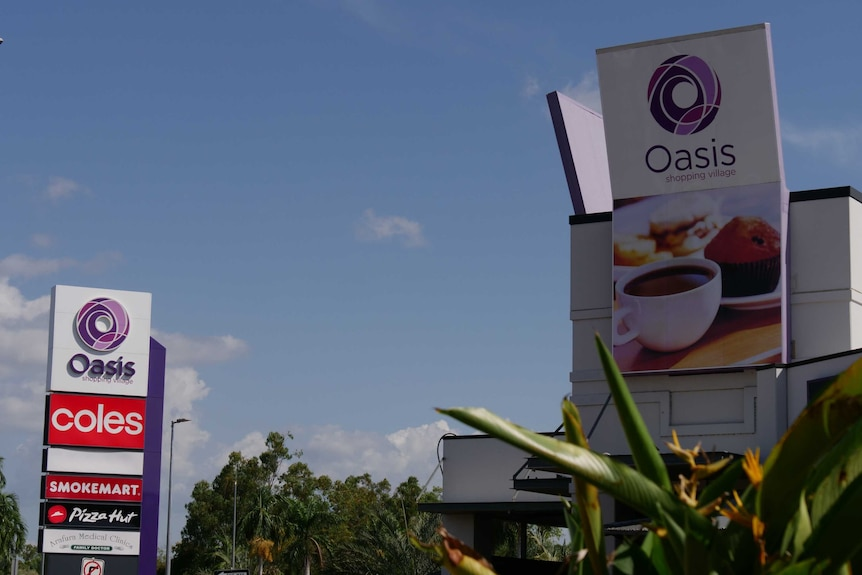 A sign outside of Oasis Shopping Village shows that there is a Coles, Smokemart and Pizza Hut in the centre.